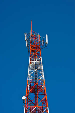 Mobile phone communication repeater antenna tower in blue sky Stock Photo - 8338465