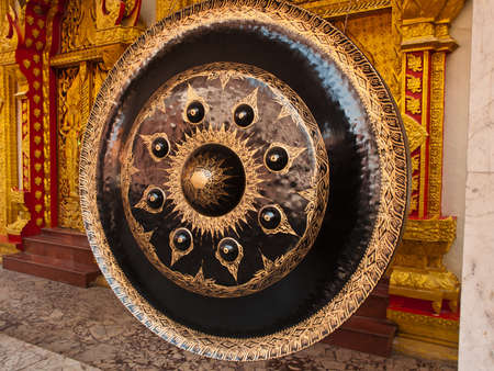 antique dishes: old gong in thai temple Stock Photo