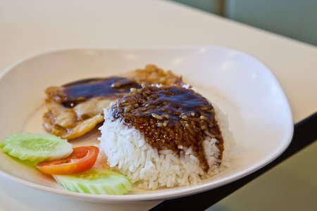 grilled chicken, rice with teriyaki sauce and tomato photo