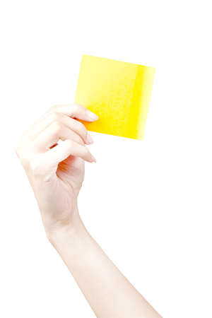 Hand and Post-it isolated on white Stock Photo - 9911540