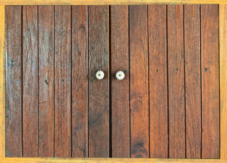 Closed window with old wood shutters photo