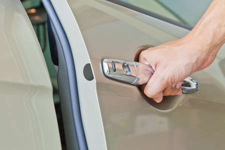 handle: Hand open door car Stock Photo