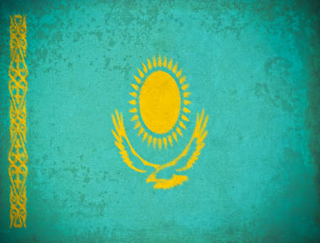 old grunge paper with Kazakhstan flag background photo