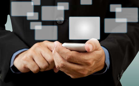 Businessman touch smart phone in hand with blank button social network photo
