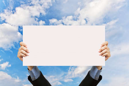 blank card: businessman holding blank sign and hand in sky