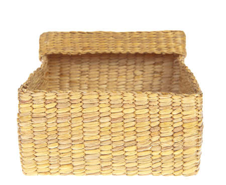 open wicker basket isolated on white background photo
