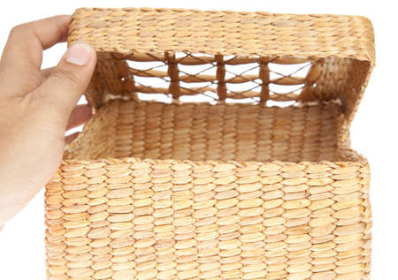 hand open wicker basket isolated on white background photo