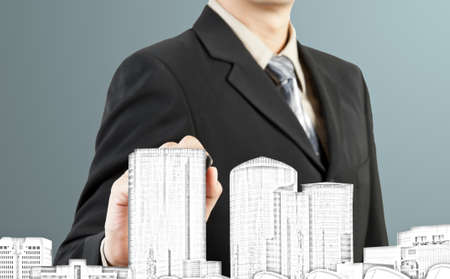 Business man draw building and cityscape photo