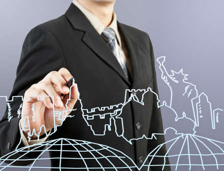 businessman hand drawing the dream travel around the world photo
