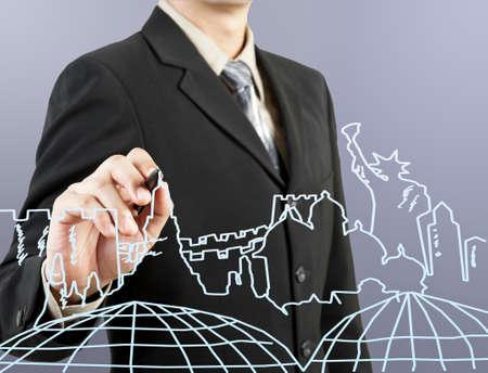 businessman hand drawing the dream travel around the world photo