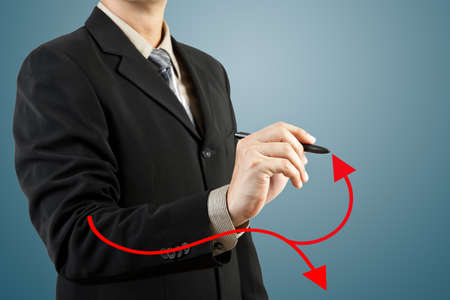 businessman hand drawing chart red arrow photo