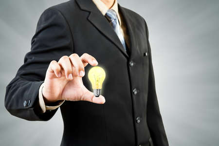 Light bulb in businessman hand photo