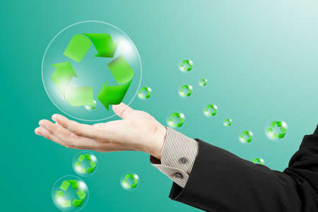 environmentalist tag: Recycle sign on business hand Stock Photo