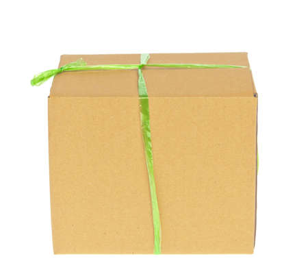 Corrugated cardboard box with green rope photo