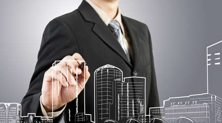 Business man draw building and cityscape Stock Photo - 13550799