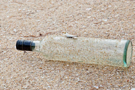 garbage bottle on the beach photo