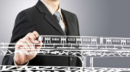 Business man draw train transportation and cityscape Stock Photo