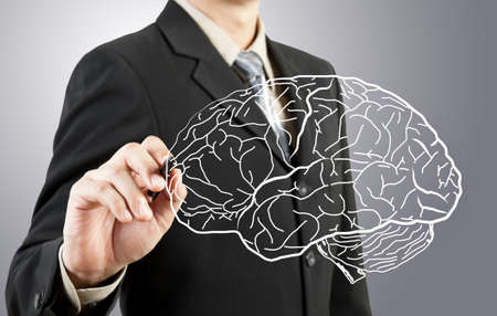 lamp power: Business man drawing human brain diagram