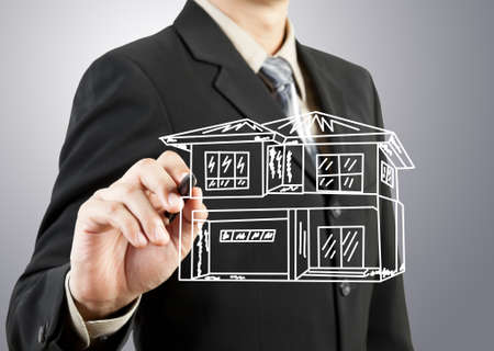 Businessman hand drawing house Stock Photo