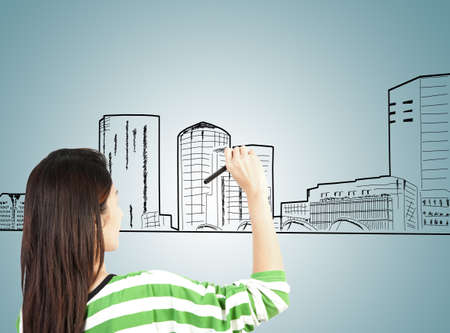 woman draw building and cityscape photo