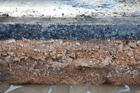 Layer soil beneath asphalt cement concrete photo