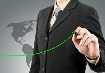 businessman hand drawing chart green arrow photo