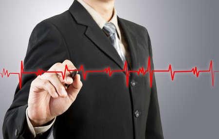 business man drawing chart heartbeat photo