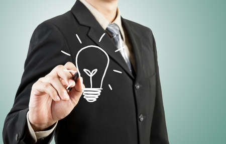 business man drawing light bulb idea photo