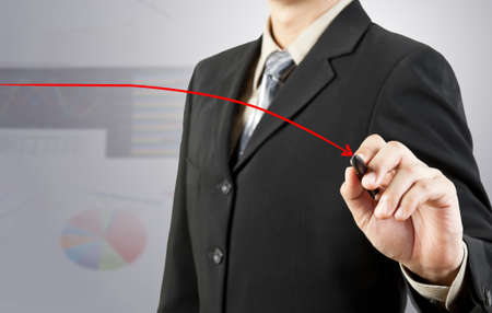 businessman hand drawing chart red down arrow photo