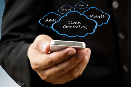 data transmission: Businessman holding mobile phone Cloud computing concept