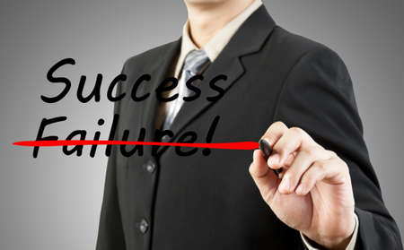 Motivation concept  Businessman write the word success and failure photo
