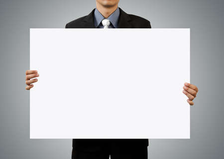 present presentation: businessman holding blank sign and hand on white