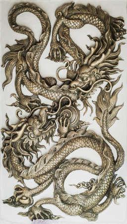 dragones: Drag�n escultura en la pared