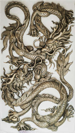 chinese temple: Dragon sculpture on wall
