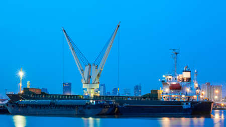 Logistic concept, container cargo ship transport import export in harbor and crane Stock Photo