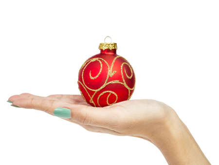 female woman hand holding Christmas ball photo