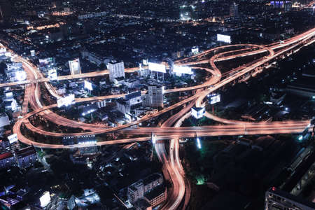 crowded space: Cityscape night and traffic car lighting, Bangkok bird eye view Stock Photo