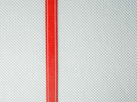 Leather with red ribbon background photo
