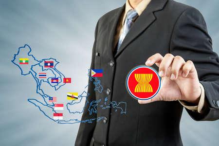 ASEAN Economic Community in businessman hand