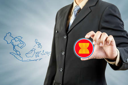 asean: ASEAN Economic Community in businessman hand