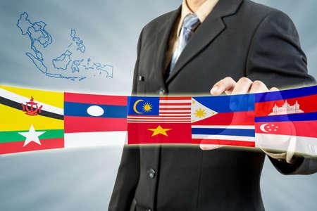 manos unidas: Comunidad Econ?mica de la ASEAN en la mano empresario