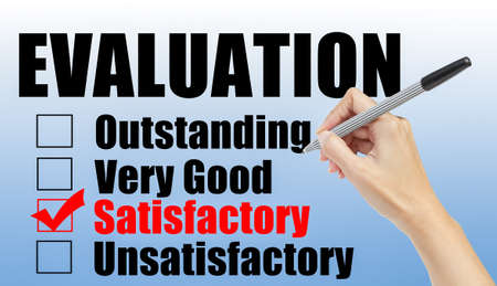 satisfactory: Evaluation form and hand check satisfactory Stock Photo