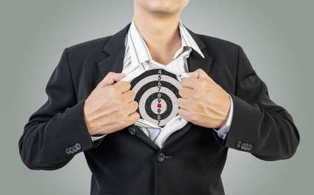 businessman showing target under shirt Stock Photo - 18489635