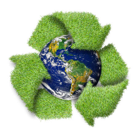 Recycle logo symbol from the green grass and earth.  photo
