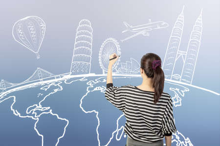 asian woman drawing or writing dream travel around the world Standard-Bild