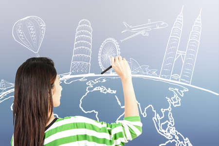 asian woman drawing or writing dream travel around the world photo