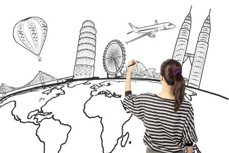 world travel: asian woman drawing or writing dream travel around the world Stock Photo