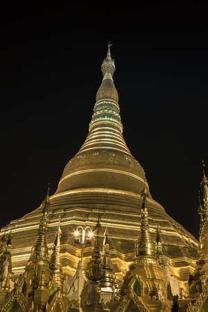 Shwedagon pagoda in Yangon, Burma (Myanmar) at night photo