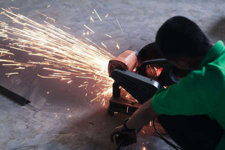 worker cutting steel and spark photo