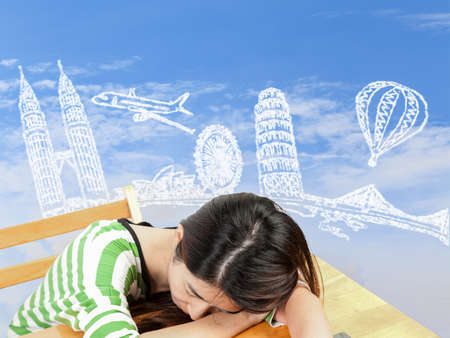 Asian woman dreaming about travel and holiday photo